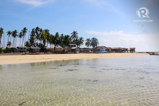SMALL TOWN, CLEAR WATERS. A small community of Sama Dilaut and Tausug in Saluag
