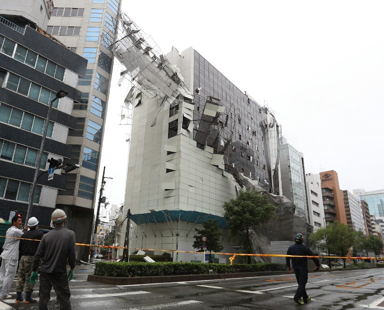 Damage from loose construction scaffolding due to weather patterns from Typhoon Jebi is seen in Osaka on September 4, 2018. Photo by Jiji Press/AFP