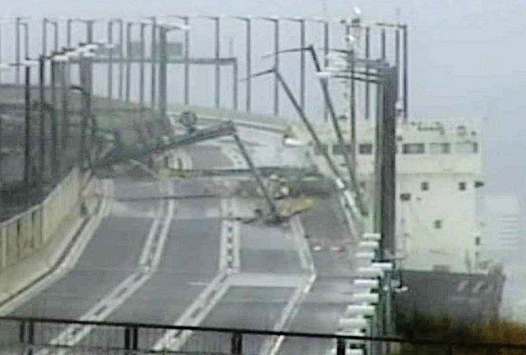 A tanker ship (R) that had smashed into a bridge connecting the city of Izumisano with Kansai international airport, with the top part of the ship knocking away a part of the bridge, as Typhoon Jebi made landfall around midday in southwestern Japan. Photo by Jiji Press/AFP