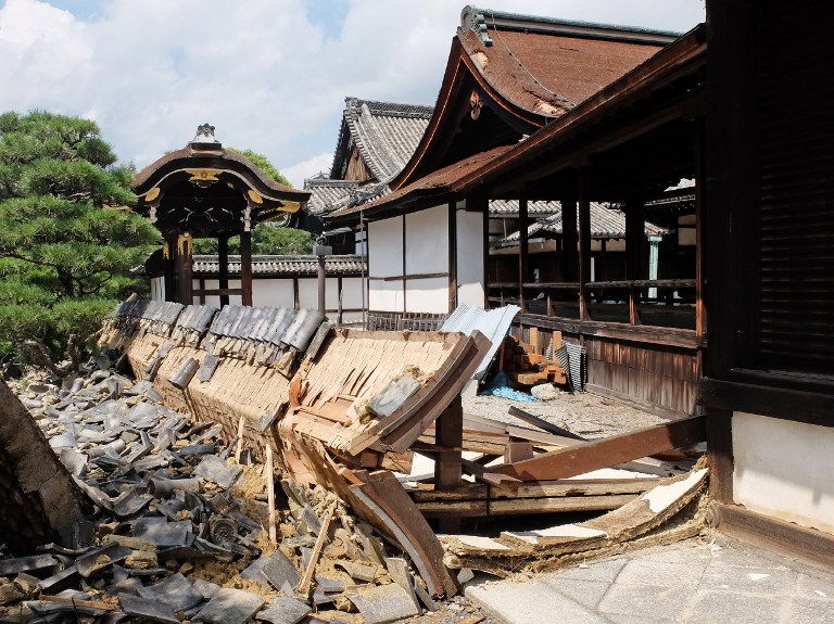 This photo shows a wall of the South Noh stage at Nishi Honganji temple damaged by Typhoon Jebi the day before in Kyoto on September 5, 2018. Photo by Jiji Press/AFP