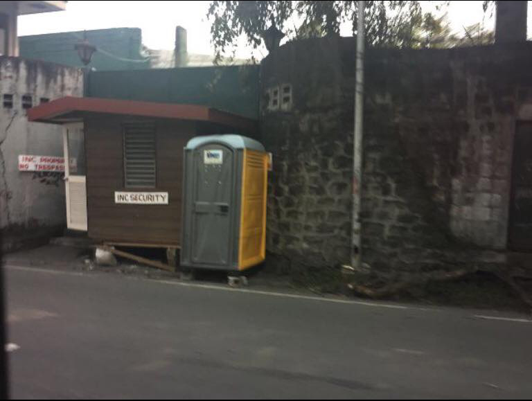 BLOCKED. A portable toilet and a guardhouse block the gate of the Manalo residence in Quezon City.