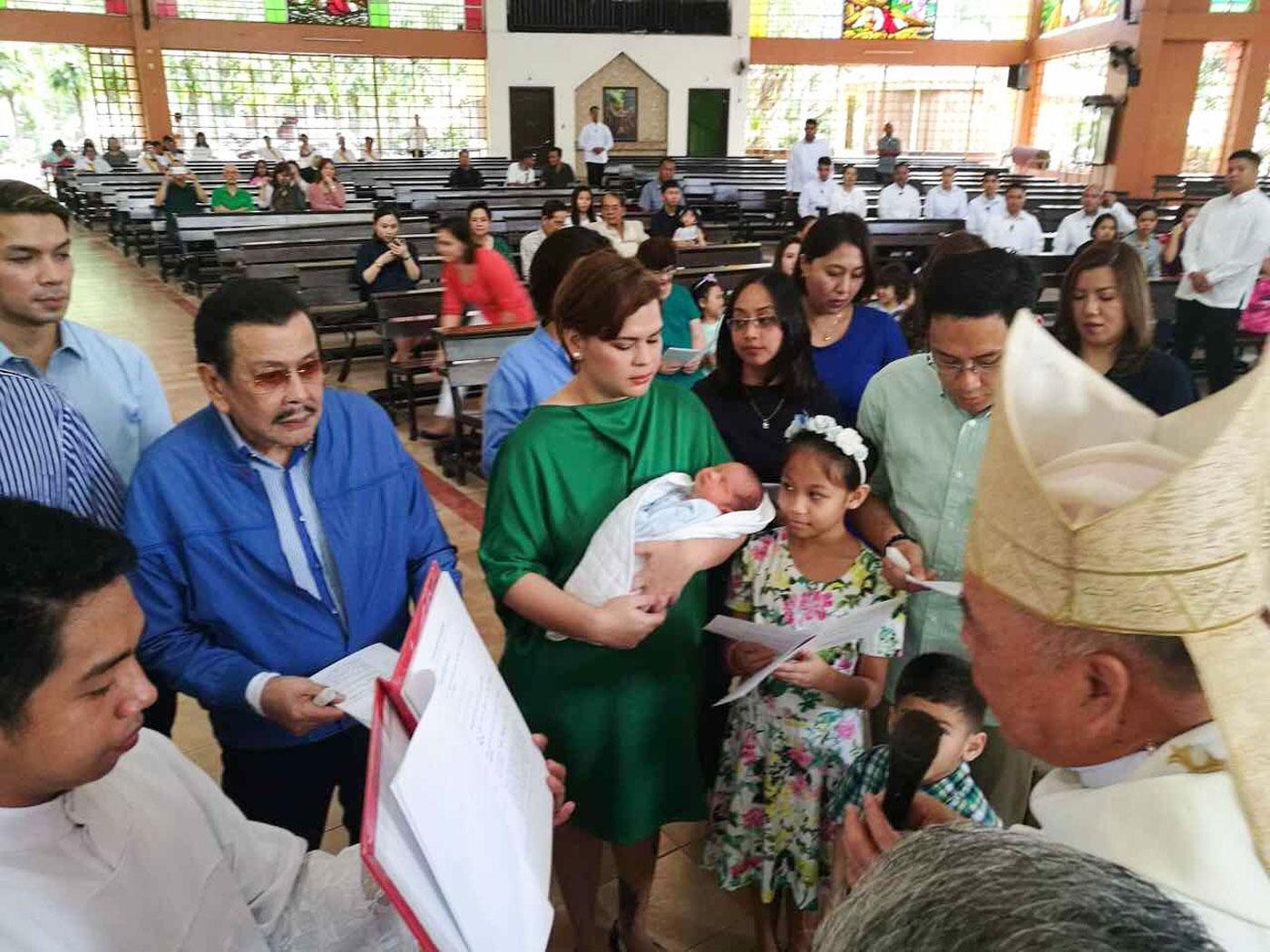 CHRISTENING. Davao City Mayor Sara Duterte-Carpio holds Stonefish as he is baptized in the presence of his godparents, including Manila Mayor Joseph Estrada. Photo from Jefry Tupas/Davao CIO