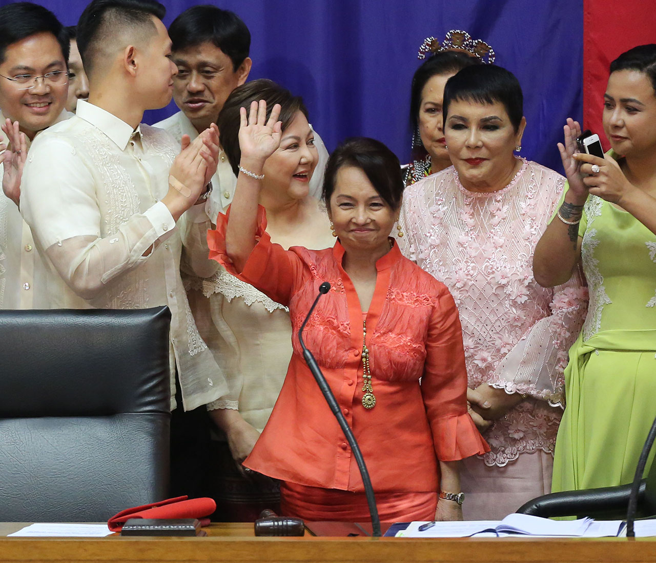 NEW SPEAKER. Pampanga Representative Gloria Macapagal Arroyo waves from the rostrum before the start of the 3rd State of the Nation Address of President Duterte at the House of Representatives. Photo by Mary Grace dela Serna/Rappler