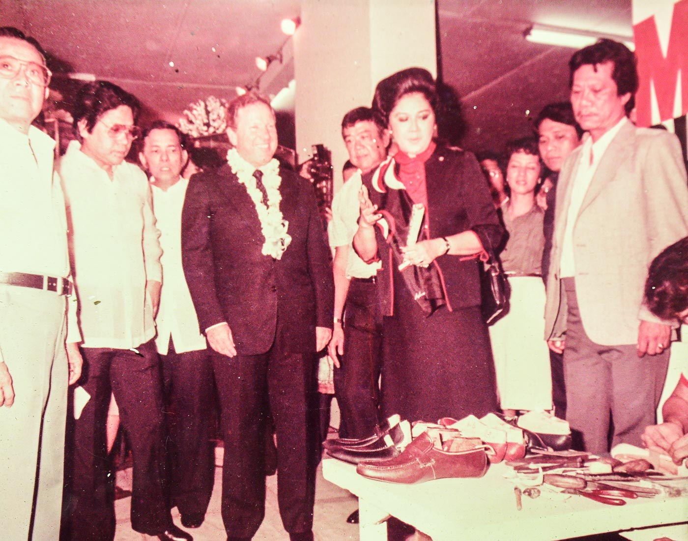 SHOE LOVER. One of the photos featured in the Marikina Shoe Museum shows Imelda Marcos watching a shoemaker. Photo from the Marikina Shoe Museum