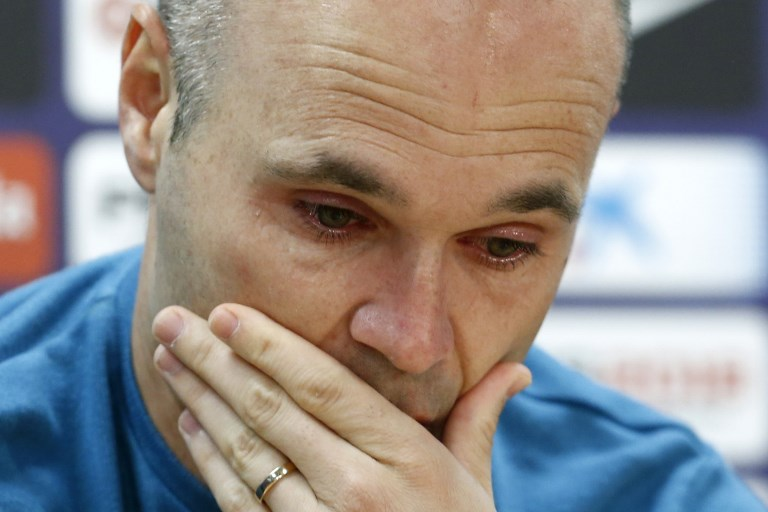 EMOTIONAL. Iniesta tries to hold back tears as he confirms leaving Barcelona at the end of the season. Photo by Pau Barrena/AFP