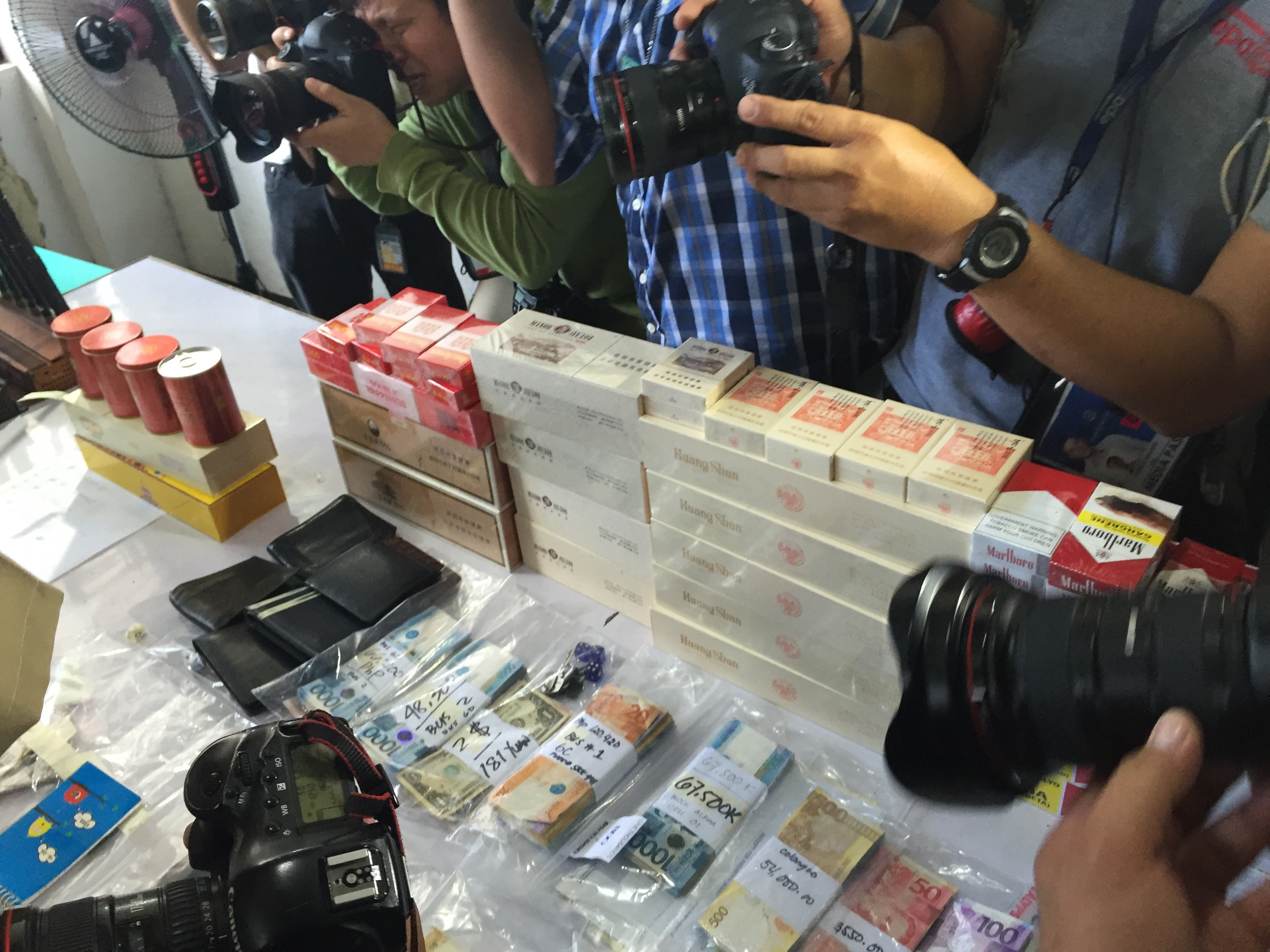 CONFISCATED. Contraband items including cigarettes, crash, and wallets with cash are seized from inmates in the New Bilibid Compound. Photo by Bea Cupin/Rappler