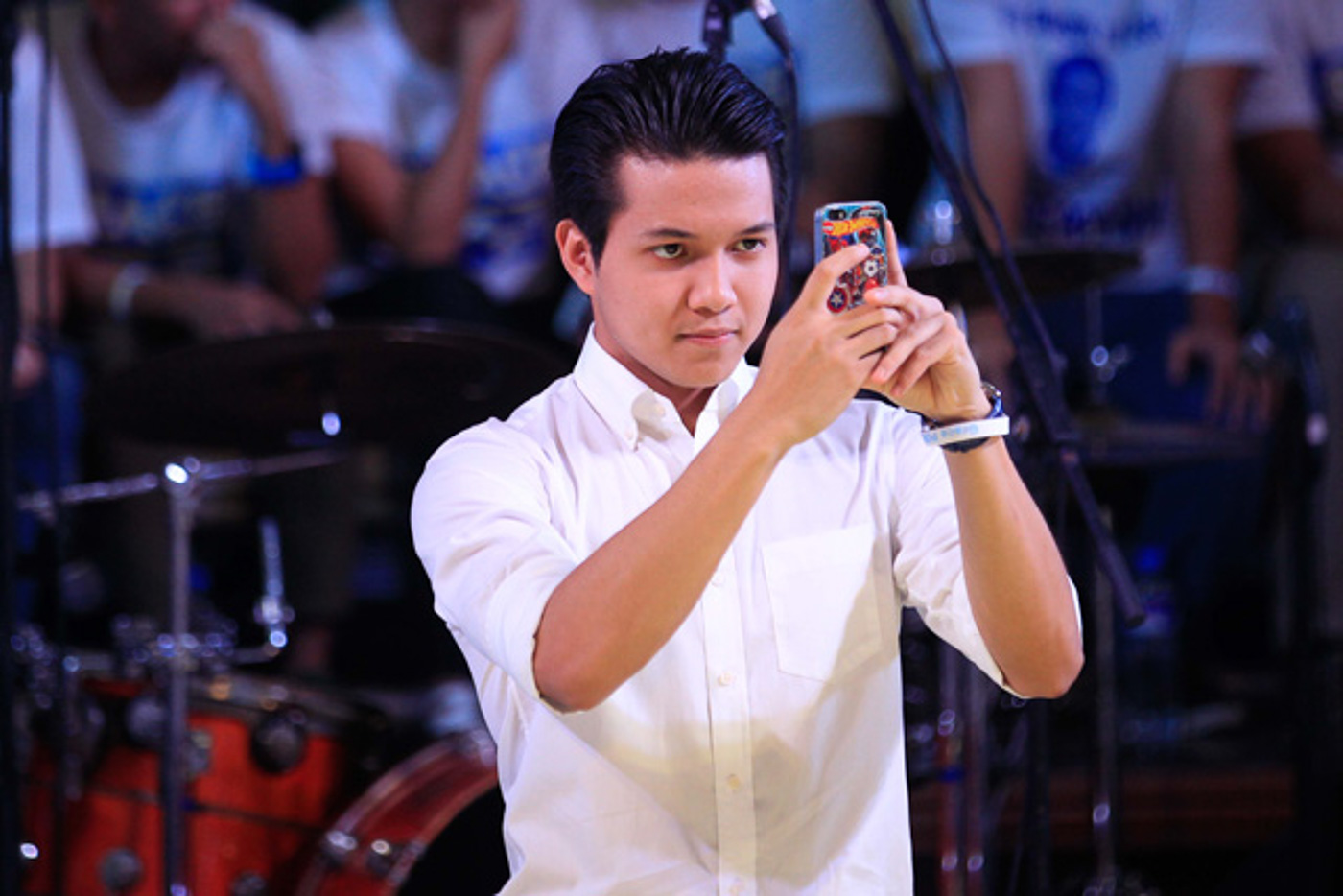 NEWS REPORTER ON LEAVE. Brian Poe Llamanzares takes a photo of his mom, Grace Poe, as she declares her bid for the presidency at the UP Bahay ng Alumni on September 16, 2015. File photo by Czar Dancel/Rappler