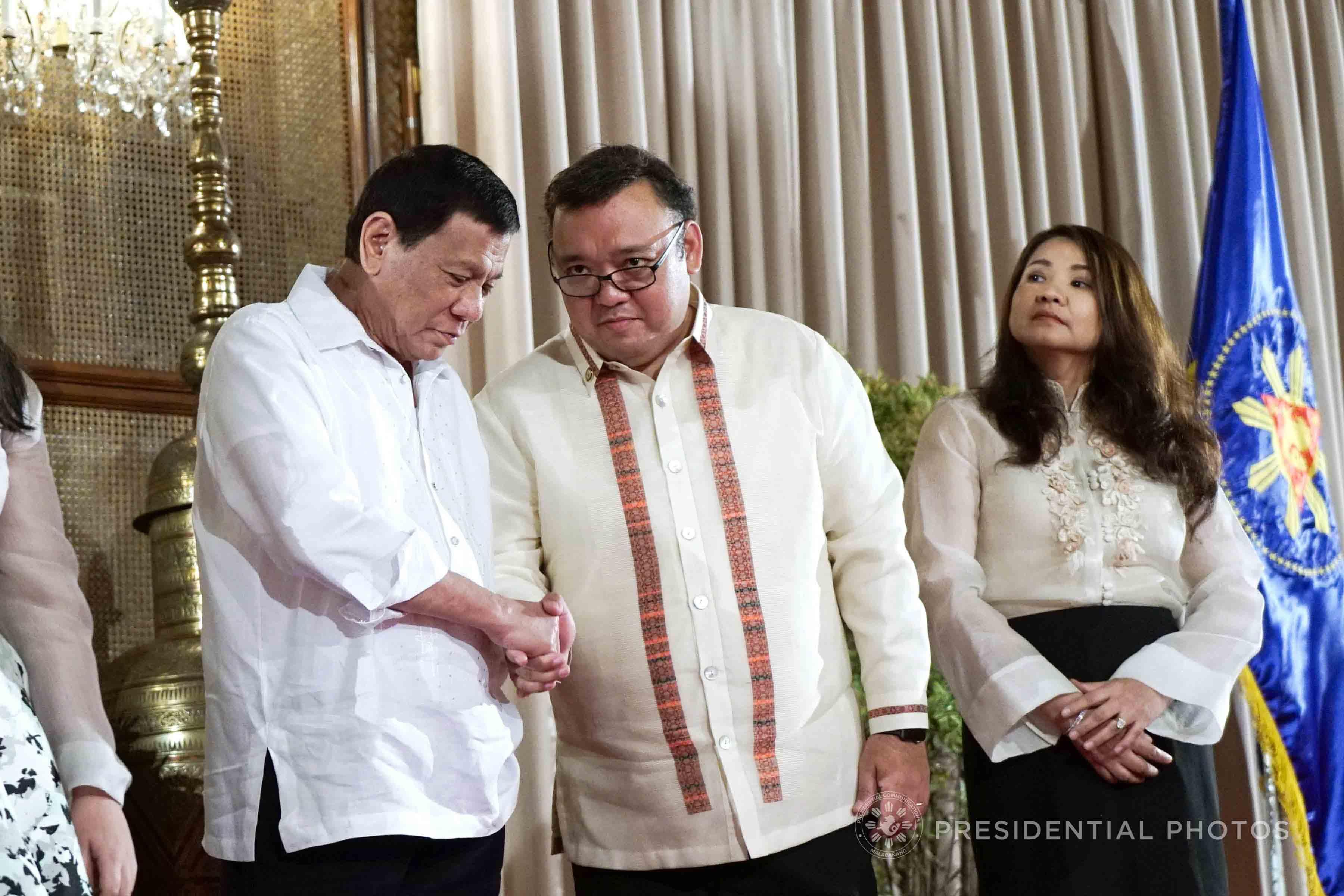 NEW JOB. President Rodrigo Duterte congratulates newly-appointed Presidential Spokesperson Harry Roque following his oath-taking ceremony. Malacau00f1ang photo