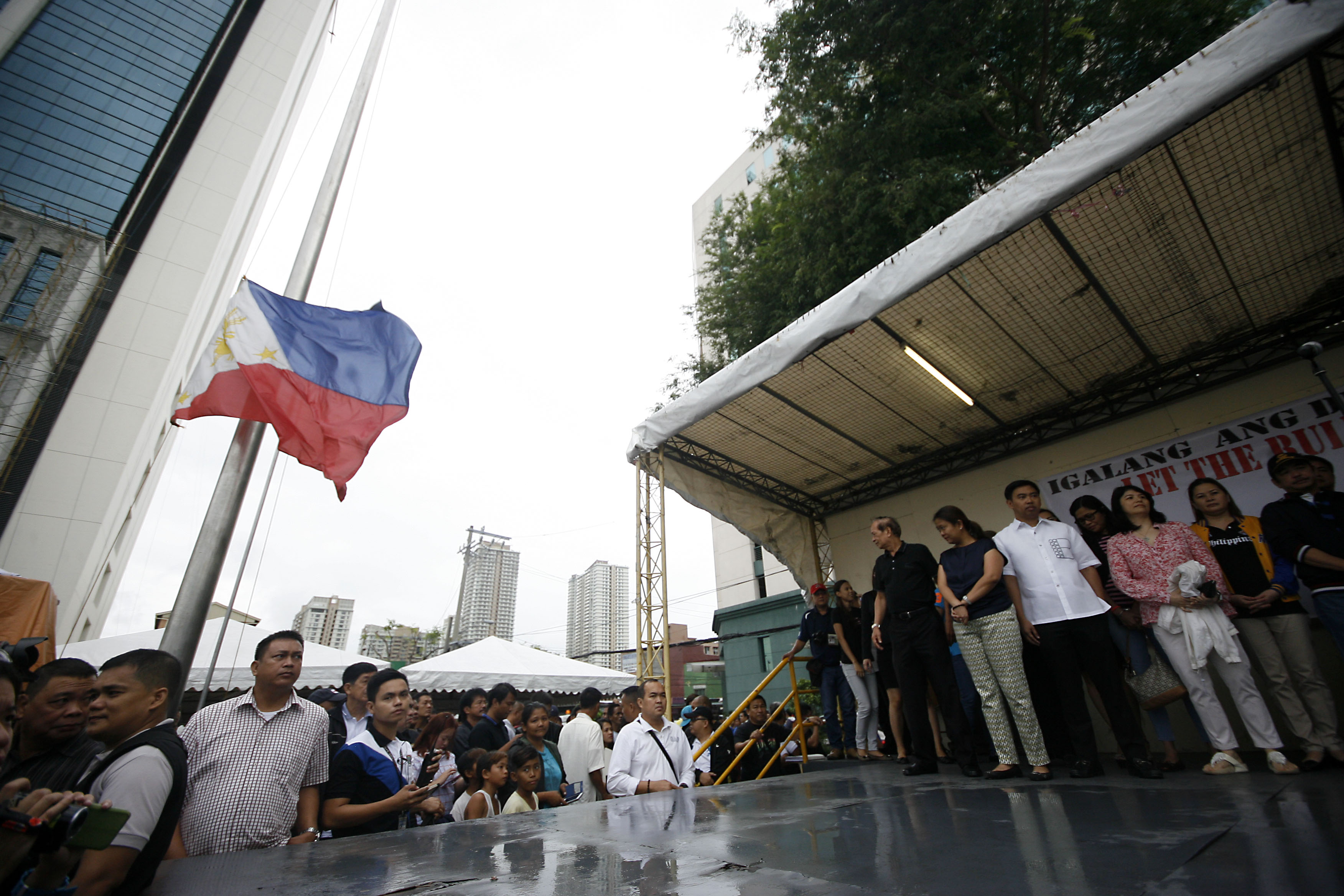 Makati City mayor Junjun Binay attends the flag raising ceremony with sister, Senator Nancy Binay, and other supporters at the new Makati city hall grounds on Monday. Photo by Ben Nabong/Rappler