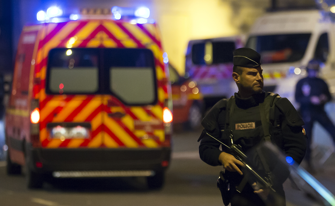 'TERRORIST' ATTACKS. Police officers stand guard outside the Stade de France in Paris, France, 13 November 2015, after explosions were reported. Photo by Ian Langsdon/EPA