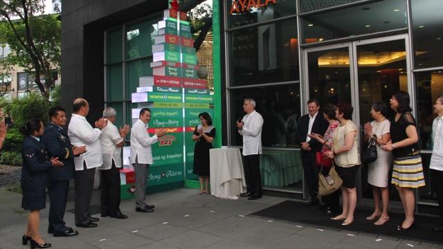 READ A BOOK. Ceremonial lighting of the book tree at the Ayala Museum plaza to commemorate the u00e2u0080u009c100 for 200u00e2u0080u009d campaign.