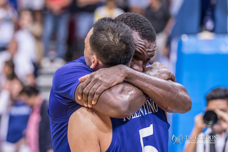 EMOTIONS. Chibueze Ikeh hugs Vince Tolentino as he realizes that this is not their last game in the UAAP. Photo by Christopher Cancio/The GUIDON.