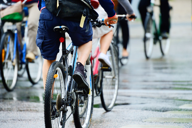 TWO-WHEELED TRANSPORT. Walking and biking are promoted as a way to travel the last 2 kilometers instead of taking motorized vehicles.