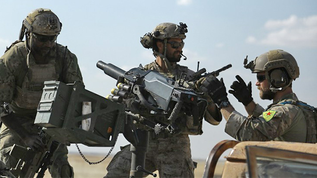 SYRIAN TROOPS. This file photo taken on May 25, 2016 shows men in uniform identified by Syrian Democratic forces as US special operations forces as they ride in the back of a pickup truck in the village of Fatisah in the northern Syrian province of Raqa. US special operations forces photographed in Syria wearing the insignia of Kurdish troops considered terrorists by Turkey have been ordered to remove the patches, a military spokesman said May 27, 2016. Ankara accused the United States, a NATO ally, of u0022unacceptableu0022 behavior for such an overt display of support for the Kurdish People's Protection Units (YPG). Photo by Delil Souleiman/AFP