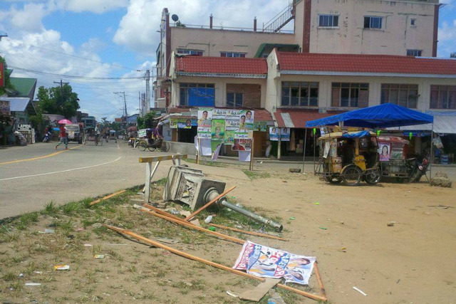 RUINED TARPS. A Northern Samar mayoral candidate claims that a barangay official ruined her campaign tarpaulin. Photo by MJ Salomon