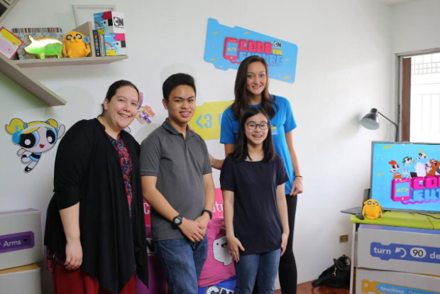 Turneru2019s Philippine Country Lead Nicole Schneiderjohn and SparkleLAB founder Rosanna Lopez with the young and talented Filipino coders, Nico Jorge and Faith Khoo