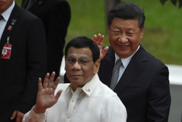 TALE OF TWO PRESIDENTS. China is out against gambling as the Philippines embraces the industry. File photo by Ted Aljibe/AFP