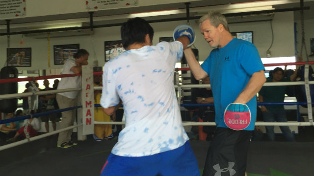 Manny Pacquiao lands a right jab while working the punch mitts with Freddie Roach. Photo by Ryan Songalia/Rappler