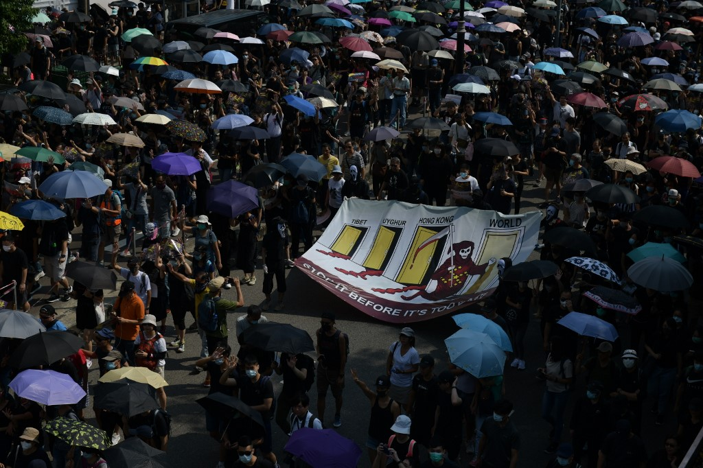 DEFIANCE. People take part in a pro-democracy march in the Tsim Sha Tsui district in Hong Kong on October 20, 2019. Photo by Ed Jones/AFP