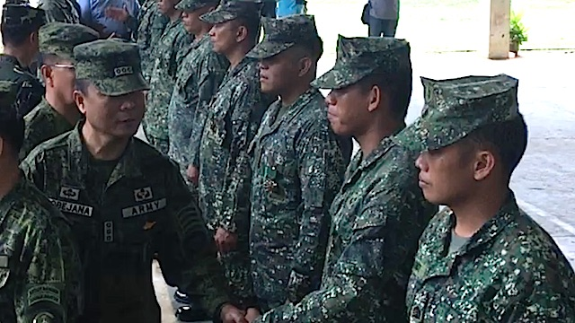MILITARY MERIT MEDALS. Joint Task Force Sulu commander Colonel Cirilito Sobejana congratulates his men. Rappler photo