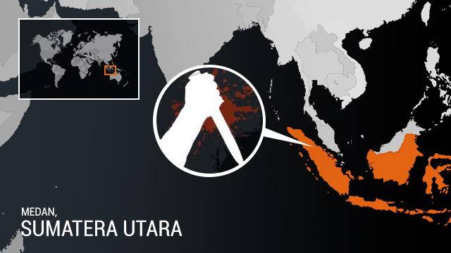 TEROR. Jelang salat Ied Fitri, pos penjagaan di Mapolda Sumatera Utara diserang oleh dua orang terduga teroris. Ilustrasil oleh Rappler