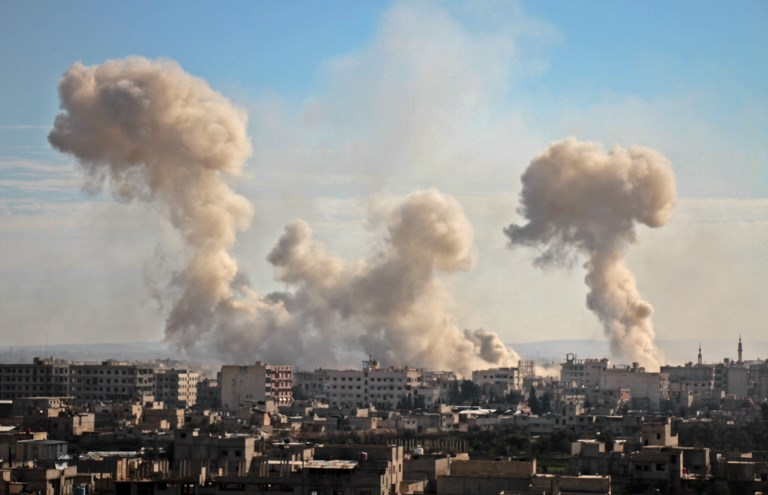 STRIKES. Smoke rises from buildings following bombardment on the village of Mesraba in the rebel-held besieged Eastern Ghouta region on the outskirts of the capital Damascus, on February 19, 2018. Heavy Syrian bombardment killed dozens of civilians in rebel-held Eastern Ghouta, as regime forces appeared to prepare for an imminent ground assault. Photo by Hamza Al-Ajweh/AFP