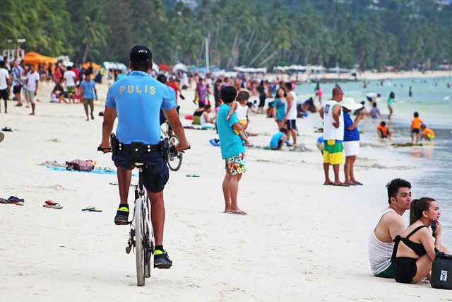 IMPENDING CLOSURE. Tourists enjoy Boracay's white sand beach prior to the island's closure to tourists starting April 26, 2018. File photo by Boy Ryan Zabal