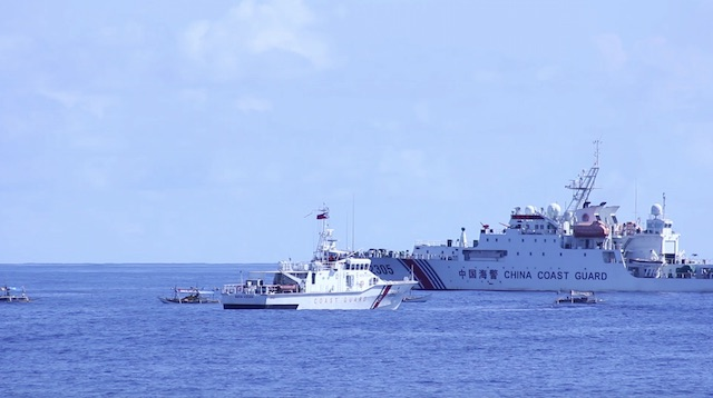 DANGEROUS MANEUVER. A Chinese Coast Guard ship blocks Philippine ship BRP Nueva Vizcaya and small Filipino fishermen's boats