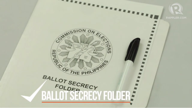 PROTECT YOUR VOTE. No one else is allowed to see your ballot. Protect it using the Comelec ballot secrecy folder. Do not take photos or makes copies of your ballot. File photo by Rappler