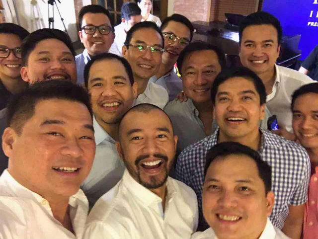 SELFIE TIME. Velasco (first from right, in white) and Alvarez (2nd from right, in light blue) smile for a selfie with the other party guests. Photo from Dy