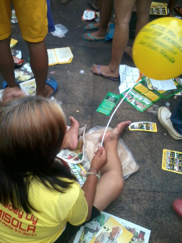 LITTERING. Flyers and leaflets are strewn on the ground during Alfredo Lim's proclamation rally in Plaza Miranda. Photo from EcoWaste Coalition