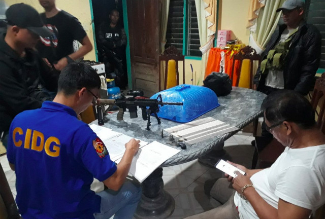 ILLEGAL. Authorities search the residents of two local officials. Photo from PNP CARAGA PIO