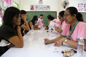 CHECK-UP. Health workers interview parents of students administered Dengvaxia. Photo from the Department of Health