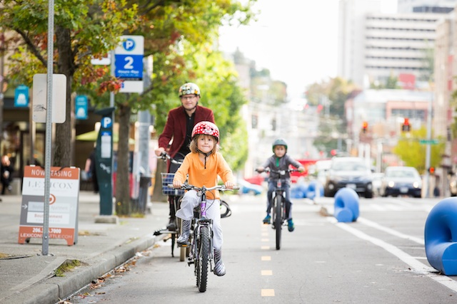 SAFE IN SEATTLE. A protected bicycle lane shows that children on bicycles are as important as citizens in cars. Photo courtesy of Adam Coppola Photography