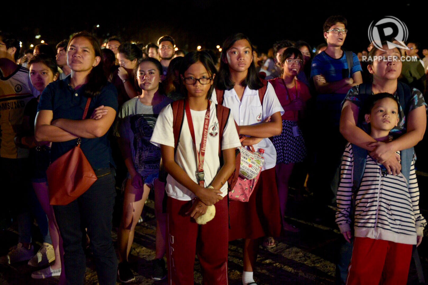 TENSED. The cardiac match gets many UP supporters all anxious at the Sunken Garden in UP Diliman. Photo by Leanne Jazul/Rappler