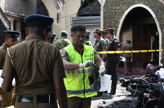 BOMBING.Sri Lankan security personnel and police investigators look through debris outside Zion Church following an explosion in Batticaloa in eastern Sri Lanka on April 21, 2019. Photo by Lakruwan Wanniarachchi/AFP