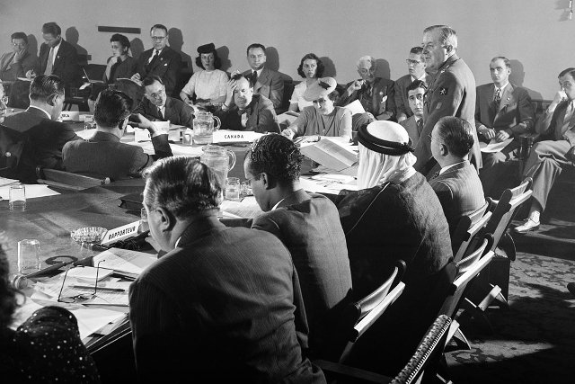CHARTER. In 1945, delegates meet in San Francisco to negotiate a charter for the organization that was to become the United Nations. Standing is Lieutenant Colonel Henri Rolin of Belgium. UN Photo