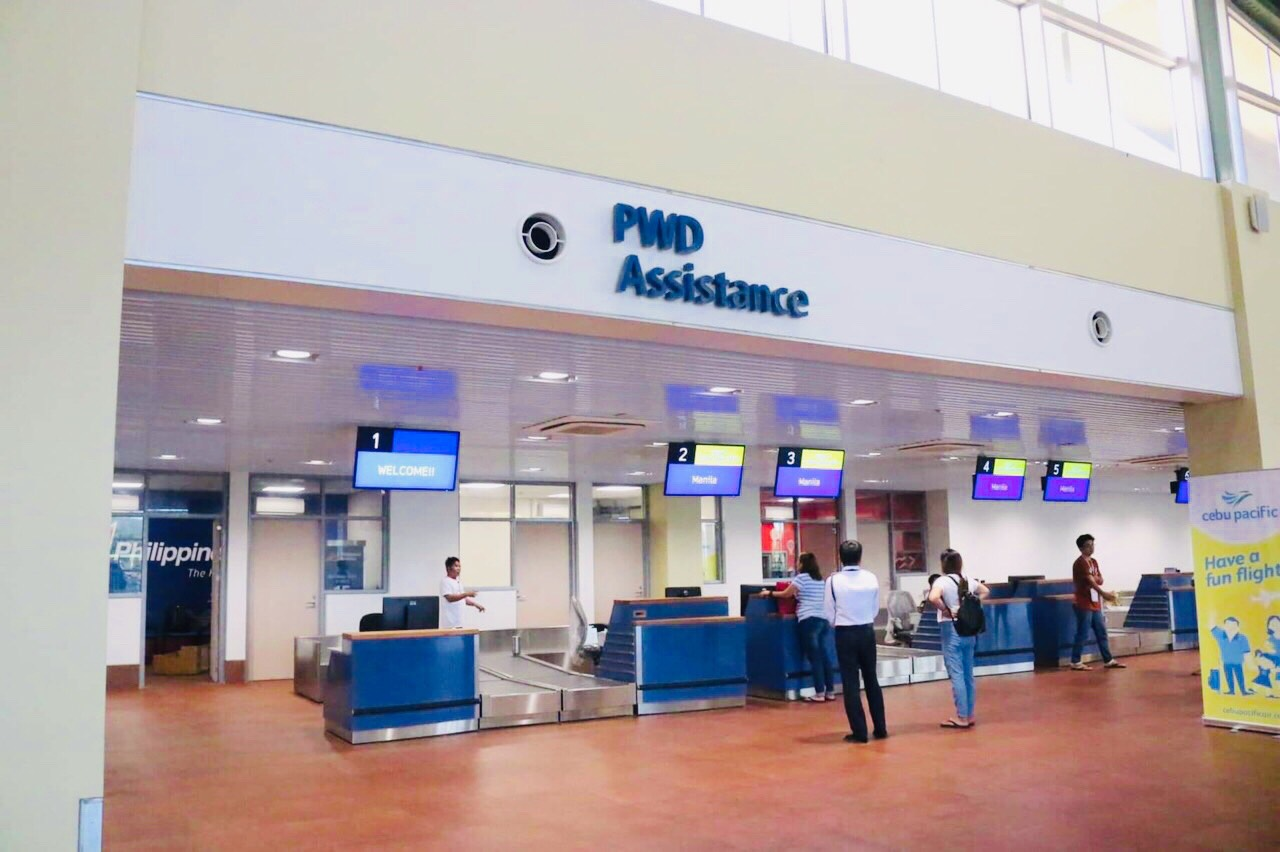 PWD ASSISTANCE. Check-in gates include counters which would provide assistance to persons with disabilities.