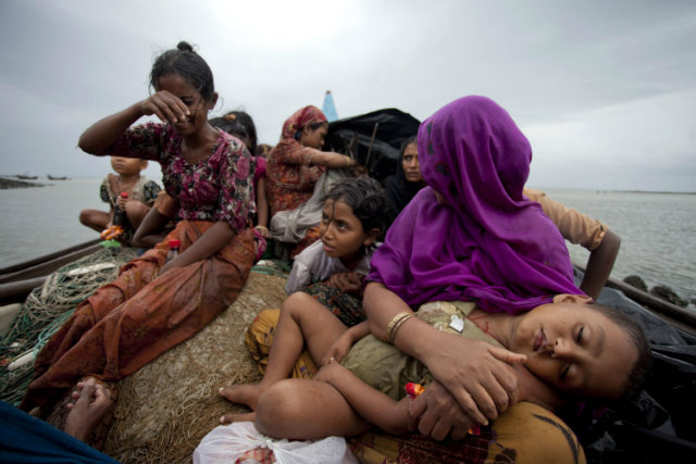 INCREASINGLY DESPERATE. Rohingya Muslim women and children fleeing sectarian violence in Myanmar sit in a boat after they were intercepted by the Bangladesh Border Guard (BGB) members in Teknaf, Bangladesh, back in June 2012. File EPA photo