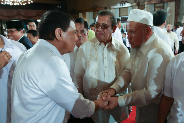 DUTERTE ADVISER. Presidential Adviser on Overseas Filipino Workers Abdullah Mamao (middle) looks on as President Rodrigo Duterte greets one of the attendees at a Palace event July 17, 2017. Malacau00f1ang file photo