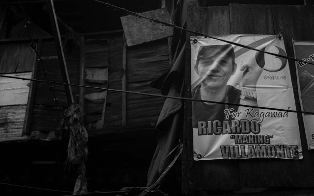 CAMPAIGN. A March 2018 local election campaign poster for Ricardo Villamonte, also known as Commander Maning, still hangs in several areas of Village 105. Photo by Carlo Gabuco