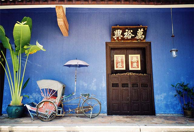 TRADITIONAL. Joy, also a photographer, captures a vibrant scene in Penang with her trusty film camera