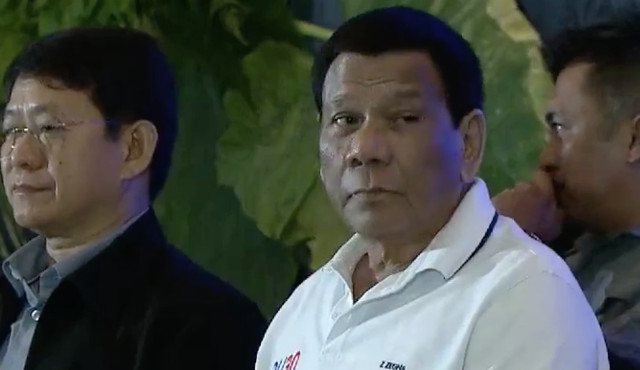 WARNING. President Rodrigo Duterte sits beside DILG officer-in-charge Eduardo Au00f1o during the League of Municipalities event in Cebu City. RTVM screenshot