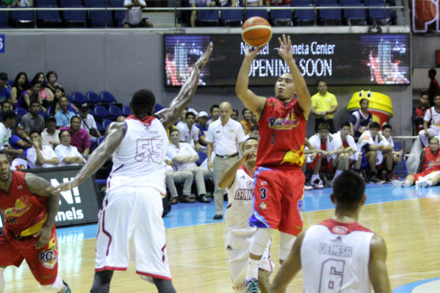 Paul Lee (R) attempts a jumper over the outstretched arms of KIA big man Hamady N'Diaye. Photo from PBA Images