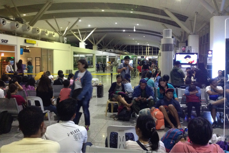 DELAYED. Passengers wait at the departure gate of Iloilo International Airport on August 17, 2018 for their delayed flights. Photo by KD Montenegro