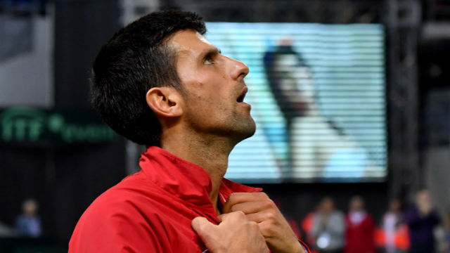 BATTLING THROUGH. Novak Djokovic prevails in the group stage of the Davis Cup. ANDREJ ISAKOVIC / AFP