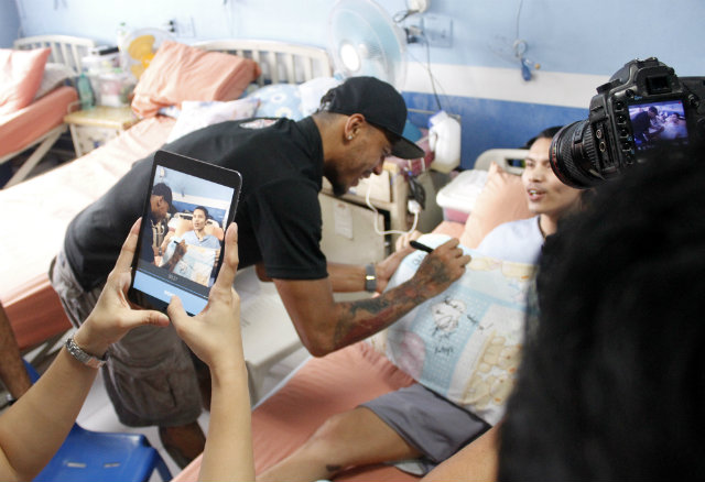 Calvin Abueva visits a Heroes' Ward with the rest of the PBA All-Stars before falling sick. Photo from PBA Images