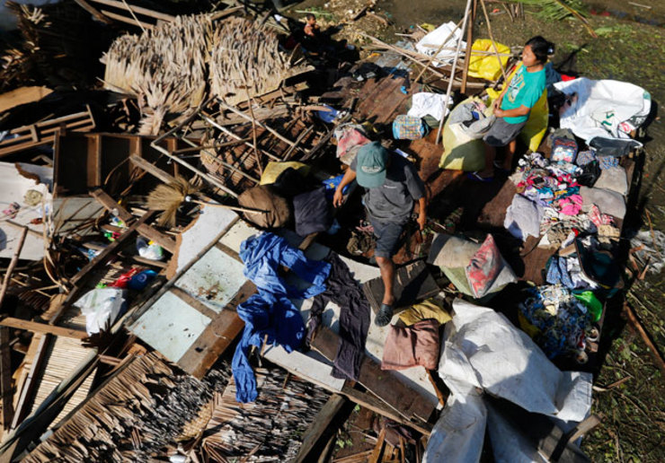 GONE. Typhoon victims Eloisa Roncales and husband, Renato, collect belongings inside of what used to be their home in the typhoon hit town of Dolores, Samar on December 8, 2014. File photo by Francis Malasig / EPA