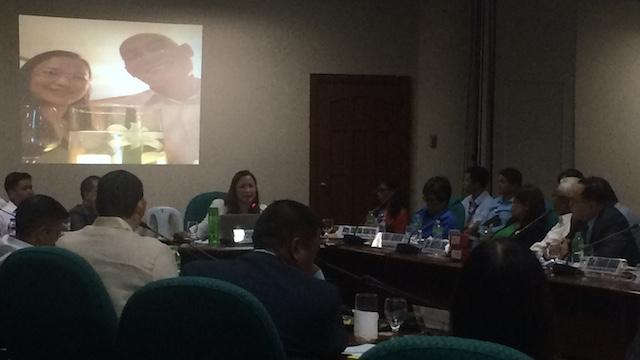 FRIENDS: Whistleblower Rhodora Alvarez presents before the Senate Blue Ribbon Committee her photo with former RASI representative Thack Nguyen