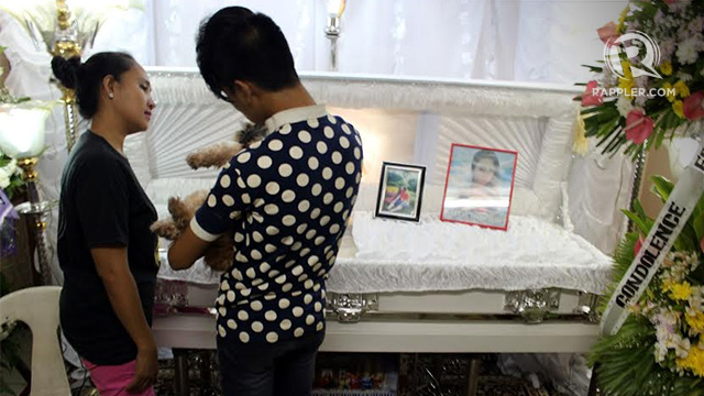 A WAKE FOR 'GANDA.' Friends of Jeffrey u201cJenniferu201d Laude, the 26-year-old transgender who was killed by a foreigner in Olongapo, look at his coffin during his wake in Olongapo City yesterday. Photo by Jose Del/Rappler